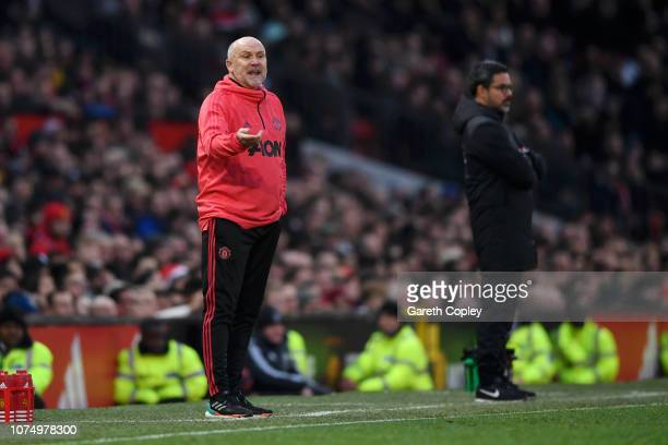 Mike Phelan, Assistant Manager of Manchester United reacts during the Premier League match between Manchester United and Huddersfield Town at Old...