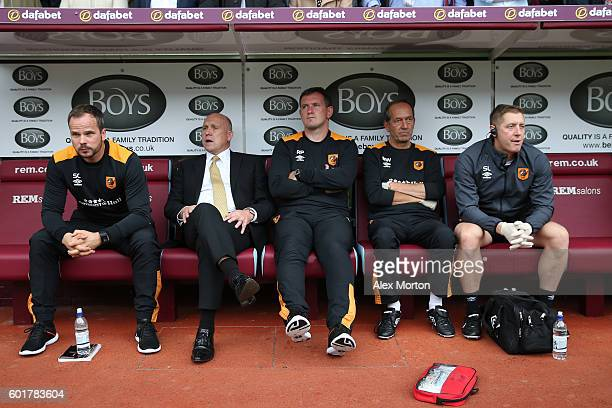 Mike Phelan caretaker Manager of Hull City and his team take their seats in the away dugout during the Premier League match between Burnley and Hull...