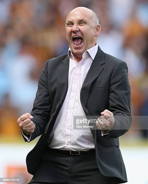 Mike Phelan caretaker Manager of Hull City celebrates on the sideline during the Premier League match between Hull City and Leicester City at KCOM...
