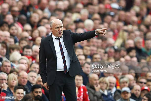 Mike Phelan caretaker Manager of Hull City gives his team instructions during the Premier League match between Liverpool and Hull City at Anfield on...