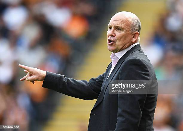 Mike Phelan caretaker Manager of Hull City gives his team instructions from the sideline during the Premier League match between Hull City and...