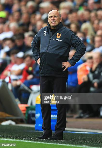 Mike Phelan caretaker Manager of Hull City looks on during the Premier League match between Swansea City and Hull City at Liberty Stadium on August...