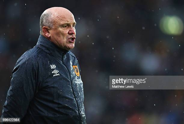 Mike Phelan caretaker Manager of Hull City looks on during the Premier League match between Hull City and Manchester United at KCOM Stadium on August...