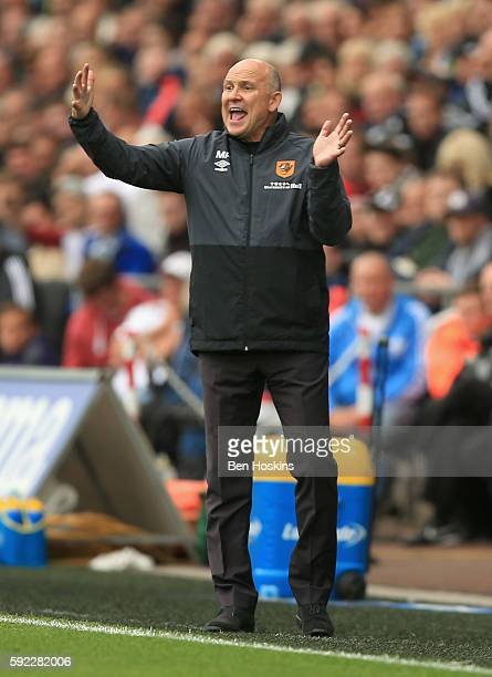 Mike Phelan caretaker Manager of Hull City reacts during the Premier League match between Swansea City and Hull City at Liberty Stadium on August 20...