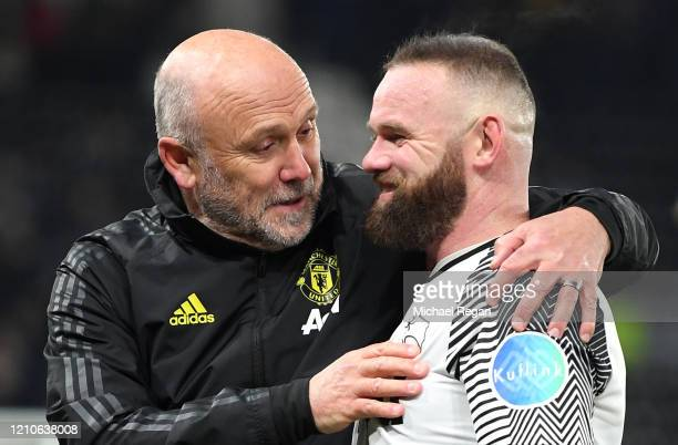 Mike Phelan coach of Manchester United with Wayne Rooney of Derby County during the FA Cup Fifth Round match between Derby County and Manchester...