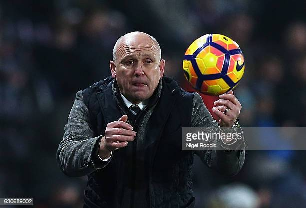 Mike Phelan Manager of Hull City throws the ball back during the Premier League match between Hull City and Everton at KCOM Stadium on December 30...