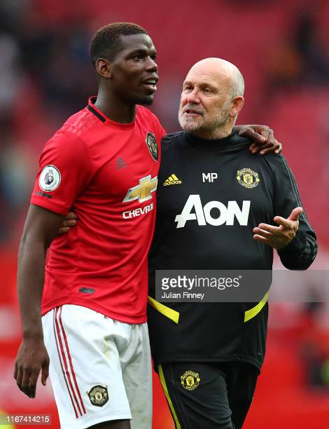 Mike Phelan of Manchester United talks with Paul Pogba of Manchester United during the Premier League match between Manchester United and Chelsea FC...