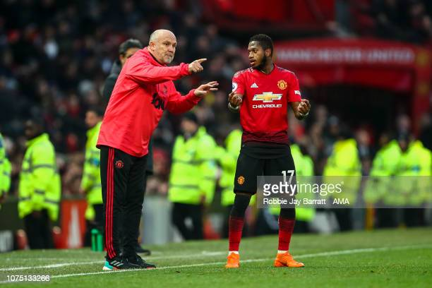 Mike Phelan the interim assistant head coach / manager of Manchester United and Fred of Manchester United during the Premier League match between...
