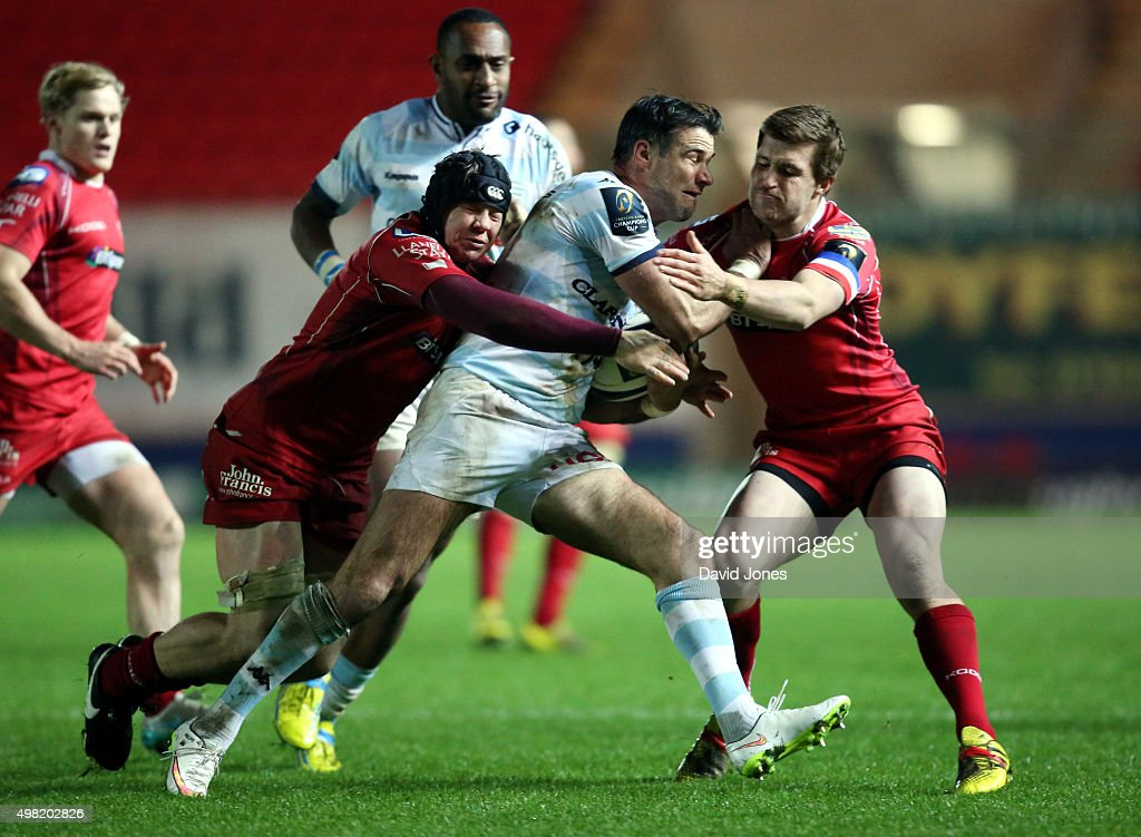 Mike Phillips of Racing 92 is tackled by James Davies of Scarlets during the European Rugby Champions Cup match between Scarlets and Racing 92 at the Parc y Scarlets on November 21, 2015 in Llanelli, Wales.