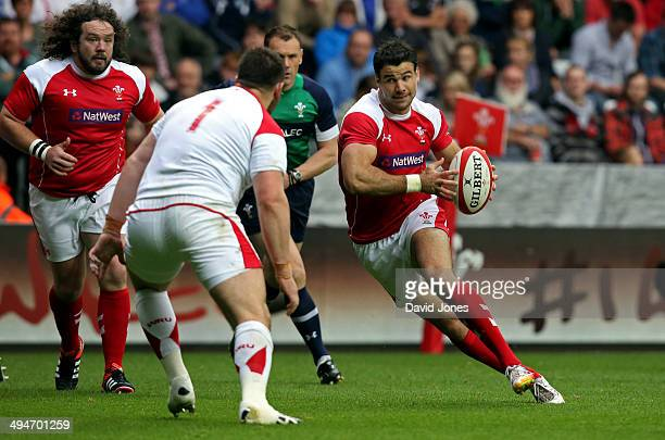 Mike Phillips of the Probables is challenged by Rob Evans of the Possibles during the Wales Senior Trial between Probables v Possibles at Liberty...