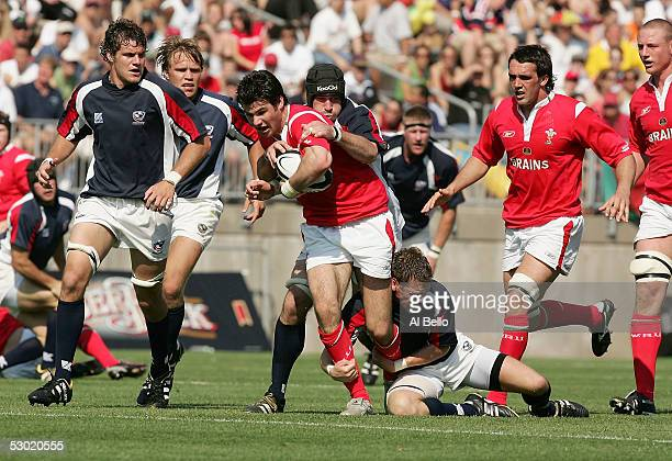 Mike Phillips of Wales runs with the ball as he is tackled by the USA defence during their International test match on June 4 2005 at Rentschler...