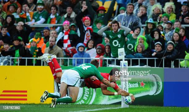 Mike Phillips of Wales touches over the line to score their second try despite the challenge of Tommy Bowe of Ireland during quarter final one of the...