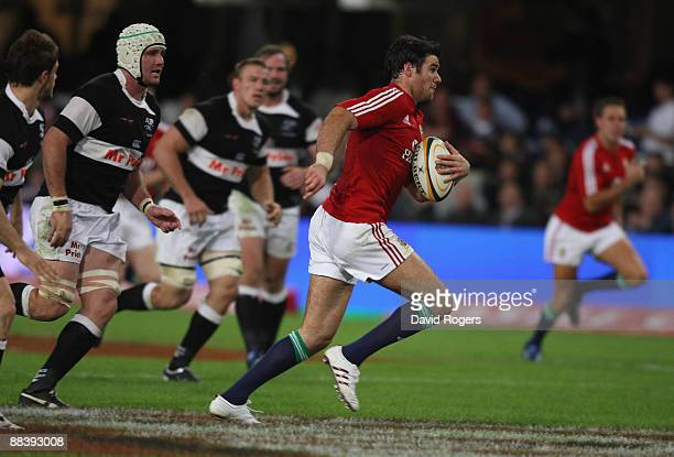 Mike Phillips, the Lions scrumhalf breaks away to score the second try during the match between the Sharks and the British and Irish Lions on their...