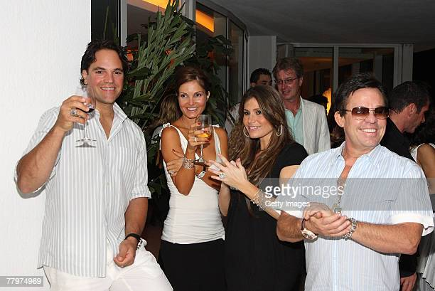 Mike Piazza Alicia Piazza Loren Ridinger JR Ridinger pose at the Audemars Piguet cocktail reception at Mike Piazza's home on November 18 2007 in...