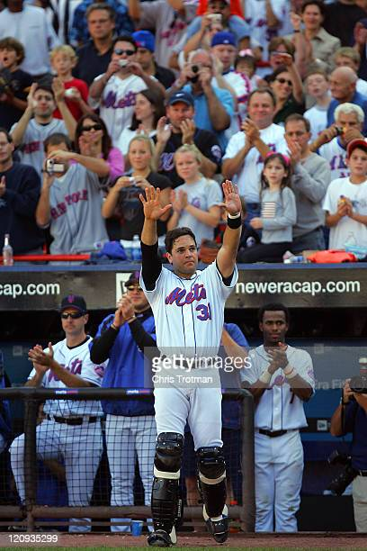 Mike Piazza catcher of the New York Mets acknowledges the fans during the 7th inning in possibly his last game as a New York Met at Shea Stadium on...