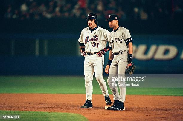 Mike Piazza of the New York Mets and Derek Jeter of the New York Yankees during Game Five of the World Series on October 26 2000 at Shea Stadium in...