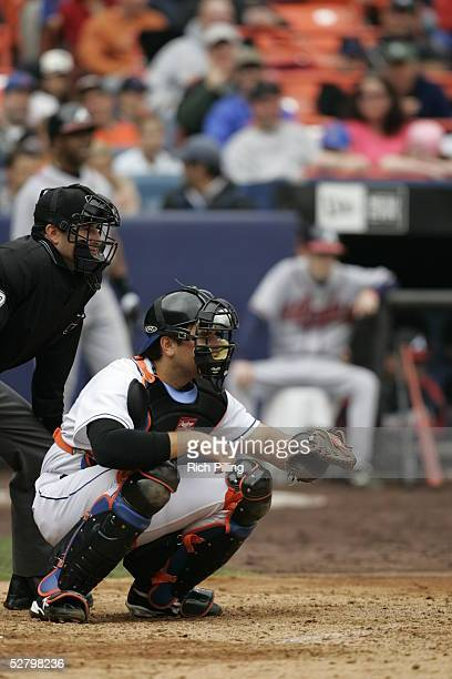 Mike Piazza of the New York Mets catches as plate umpire Jim Reynolds looks on during the game against the Atlanta Braves at Shea Stadium on April 27...