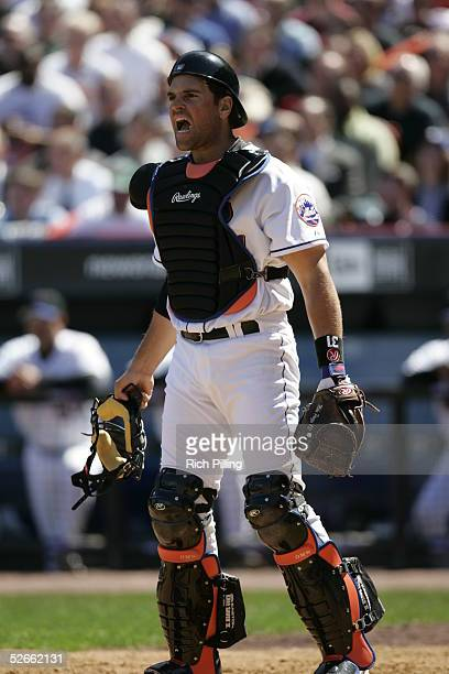 Mike Piazza of the New York Mets catches during the game against the Houston Astros at Shea Stadium on April 11 2005 in Flushing New York The Mets...