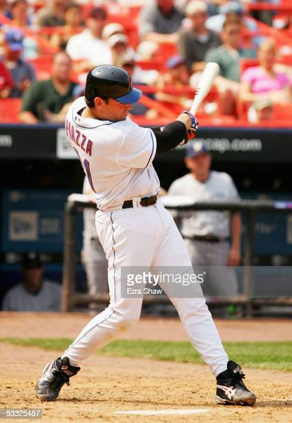 Mike Piazza of the New York Mets hits a double in the sixth inning against the Milwaukee Brewers that scored one run at Shea Stadium on August 4 2005...