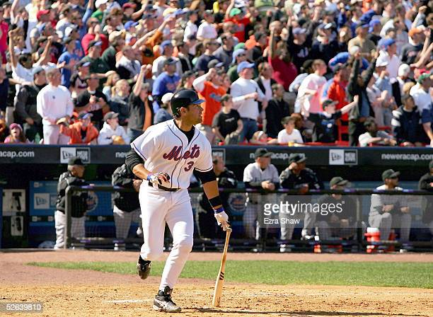 Mike Piazza of the New York Mets hits a double that scored Miguel Cairo to give the Mets a 32 in the eighth inning of their game against the Florida...