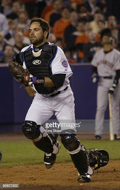Mike Piazza of the New York Mets runs back for a pop fly behind home plate during the game against the San Francisco Giants on May 6, 2004 at Shea...