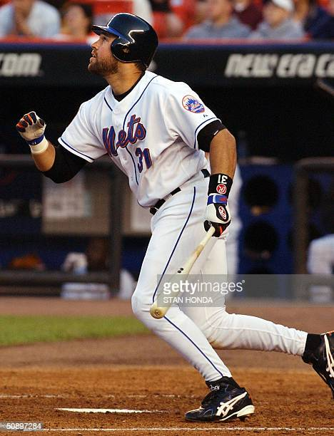 Mike Piazza of the New York Mets watches his rbi single in the 3rd inning against the Philadelphia Phillies 25 May 2004 at Shea Stadium in New York...