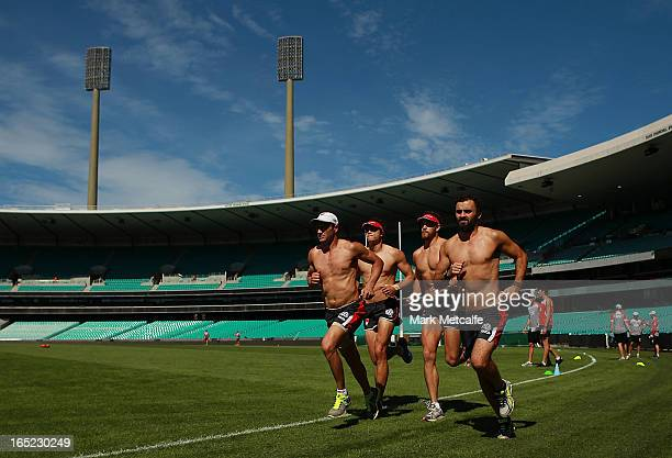 Mike Pike Jude Bolton Shane Mumford and Rhyce Shaw of the Swans run during a Sydney Swans AFL training session at the Sydney Cricket Ground on April...