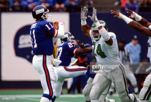 Mike Pitts of the Philadelphia Eagles puts the pressure on quarterback Phil Simms of the New York Giants during an NFL Football game December 3 1989...