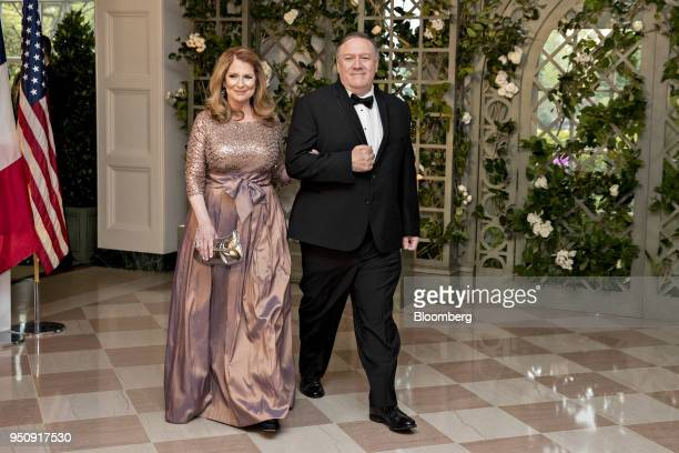 Mike Pompeo director of the Central Intelligence Agency right and Susan Pompeo arrive for a state dinner in honor of French President Emanuel Macron...