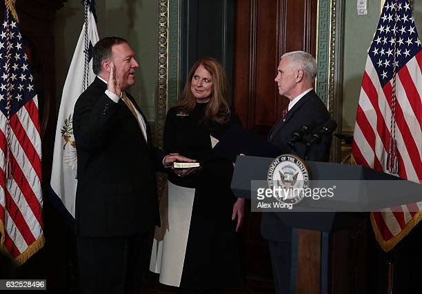 Mike Pompeo is sworn in as CIA Director by Vice President Mike Pence as wife Susan Pompeo looks on at Eisenhower Executive Office Building January 23...