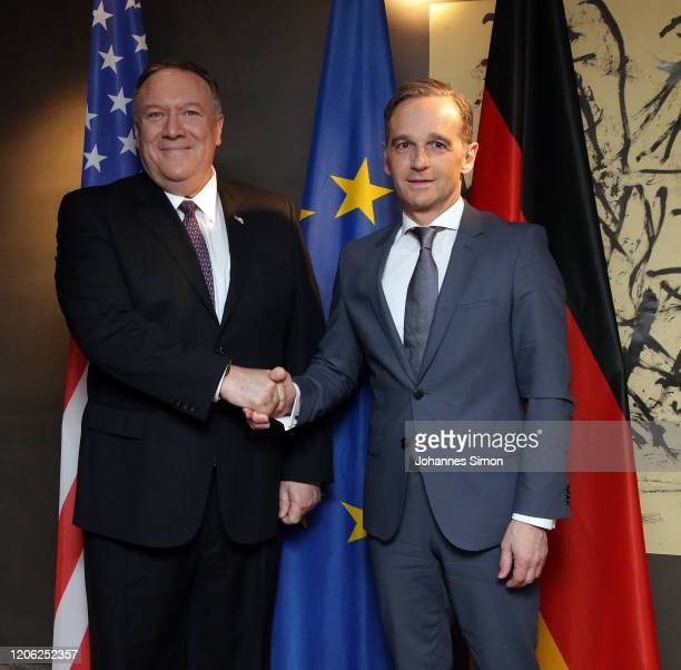 Mike Pompeo US minister of foreign affairs and his German colleague Heiko Maas shake hands ahead of a bilateral meeting at the 2020 Munich Security...