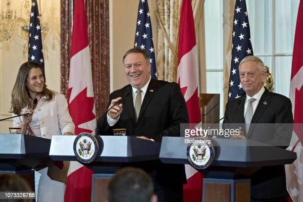 Mike Pompeo US secretary of state center and Chrystia Freeland Canada's minister of foreign affairs left smile at a news conference with James Mattis...