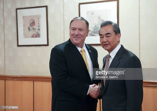 Mike Pompeo US Secretary of State greets Wang Yi State Councillor and Minister for Foreign Affair's of the People's Republic of China at the Chinese...