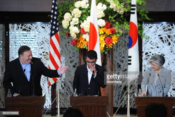 Mike Pompeo US secretary of state left gestures towards Taro Kono Japan's foreign minister center and Kang KyungWha South Korea's foreign minister...
