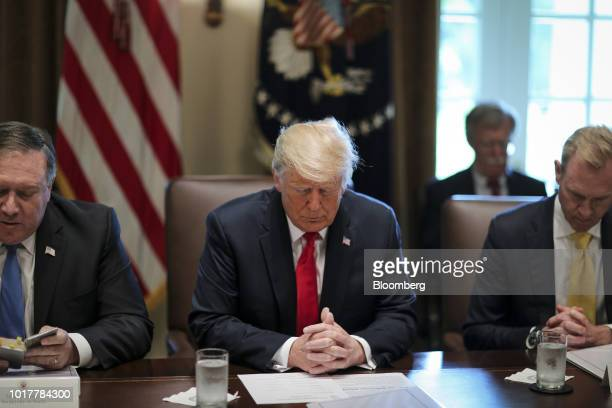 Mike Pompeo US secretary of state left reads a prayer next to US President Donald Trump center and Patrick Shanahan deputy secretary of defense...