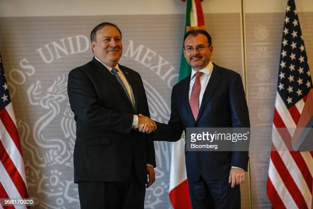 Mike Pompeo US secretary of state left shakes hands with Luis Videgaray Mexico's foreign minister during a meeting in Mexico City Mexico on Friday...