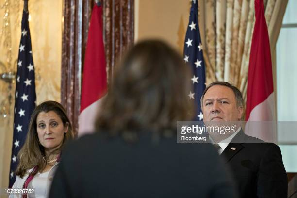 Mike Pompeo US secretary of state right and Chrystia Freeland Canada's minister of foreign affairs listen to a question at a news conference during a...