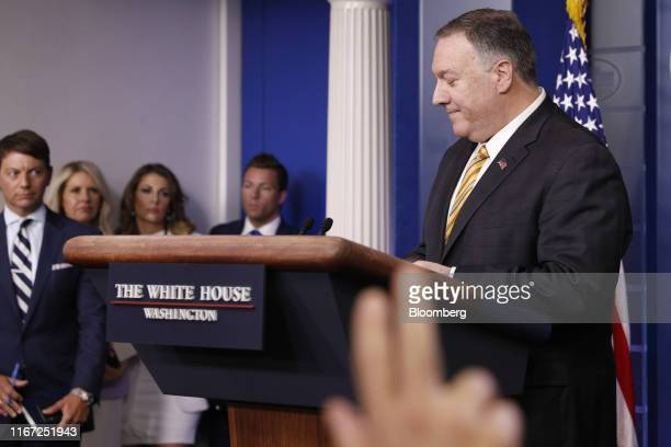 Mike Pompeo US secretary of state right takes questions during a White House press briefing in Washington DC US on Tuesday Sept 10 2019 Pompeo and US...