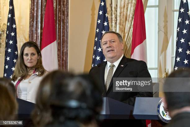 Mike Pompeo US secretary of state speaks as Chrystia Freeland Canada's minister of foreign affairs left listens at a news conference during a...