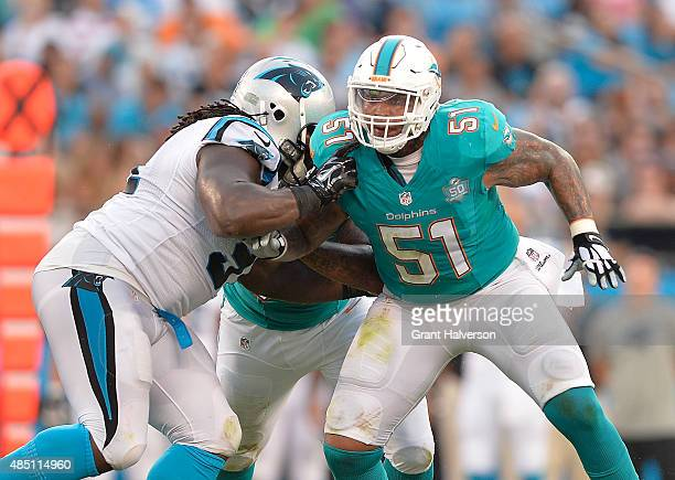 Mike Pouncey of the Miami Dolphins blocks against the Carolina Panthers during their preseason NFL game at Bank of America Stadium on August 22 2015...