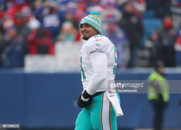 Mike Pouncey of the Miami Dolphins smiles as he takes the field during NFL game action against the Buffalo Bills at New Era Field on December 17 2017...