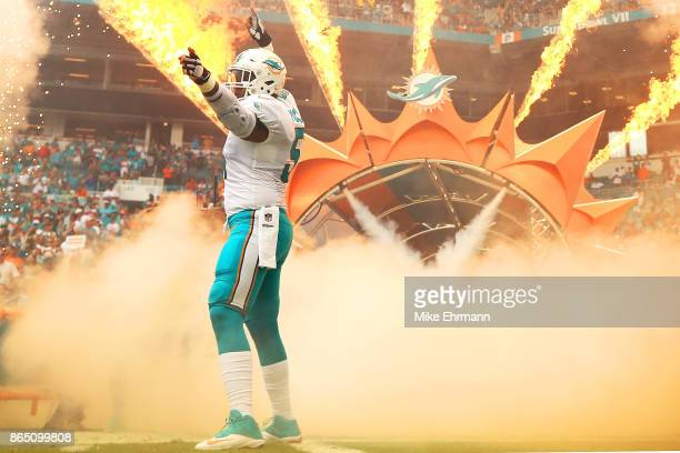 Mike Pouncey of the Miami Dolphins takes the field during a game against the New York Jets at Hard Rock Stadium on October 22 2017 in Miami Gardens...