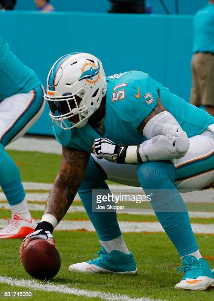 Mike Pouncey of the Miami Dolphins warms up before play against the Atlanta Falcons during a preseason game at Hard Rock Stadium on August 10 2017 in...