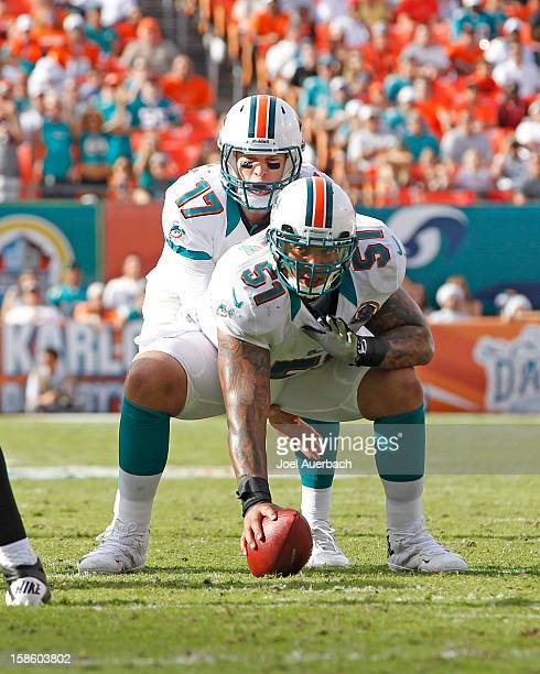 Mike Pouncey prepares to snap the ball to Ryan Tannehill of the Miami Dolphins against the Jacksonville Jaguars on December 16 2012 at Sun Life...