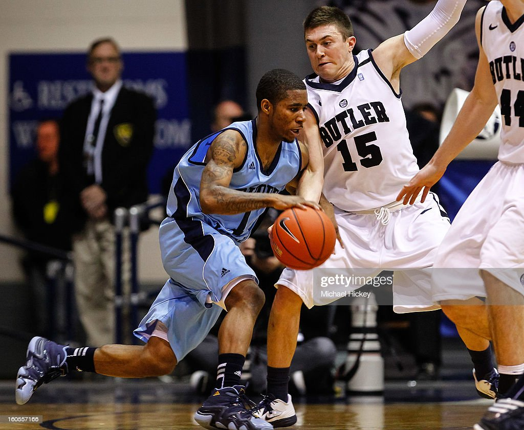 Mike Powell #1 of the Rhode Island Rams dribbles the ball against Rotnei Clarke #15 of the Butler Bulldogs at Hinkle Fieldhouse on February 2, 2013 in Indianapolis, Indiana. Butler defeated Rhode Island 75-68.