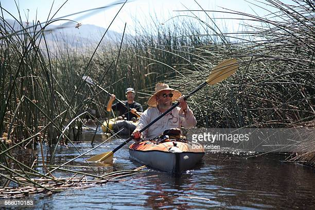 – Mike Prather long time Owen's Valley environmental activist and Larry Freilich Inyo County Midigation Projects manager navigate by kayak the tule...