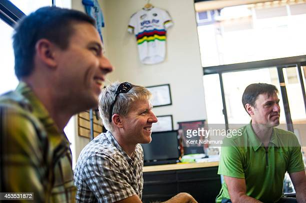 Mike Pritchard, Aaron Clark and Jamie Malin are seen during a meeting with Senator Mark Udall at The Kind Bike & Ski on Tuesday, August 12, 2014 in...