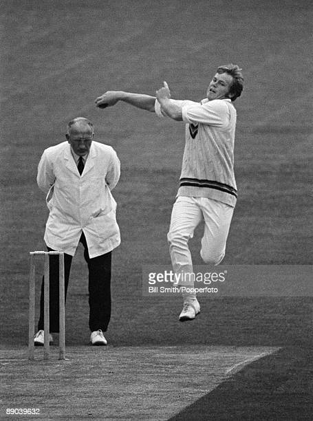 Mike Procter bowling for Gloucestershire against Northamptonshire at the County Ground in Northampton 21st June 1971 The umpire is Tom Spencer