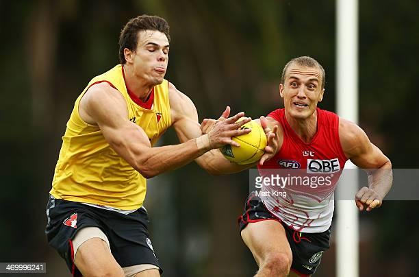 Mike Pyke competes with Ted Richards during a Sydney Swans AFL training session at Lakeside Oval on February 18, 2014 in Sydney, Australia.