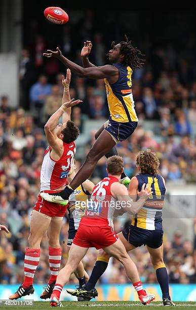 Mike Pyke of the Swans and Nic Naitanui of the Eagles contest the ruck during the round 17 AFL match between the West Coast Eagles and the Sydney...